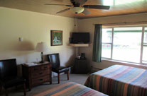 Shamrock Motel and Cottages Long Lake NY Motel room interior, TV, Ceiling fan, carpeted floors